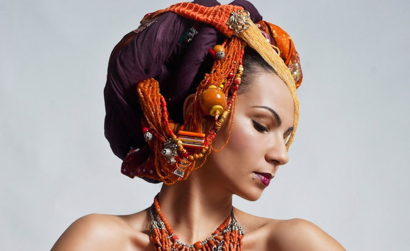 Moroccan singer / songwriter Oum wearing one of her elaborate head wraps.